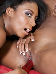 Ebony lesbian hotties work a dildo and ride the strapon