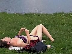 Sunbathing teen pestered by a voyeur with a camera