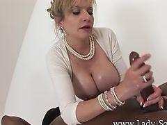 MILF Lady Sonia strokes HUGE black cock