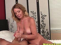 Bikini milf tugging cock while rubbing pussy