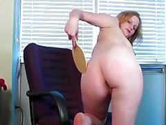 This kinky office worker likes to paddle her own round ass